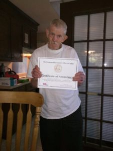 Picture of a man receiving a certificate on residents rights